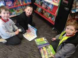 P3 enjoy browsing at the lovely books available at the Book Fair